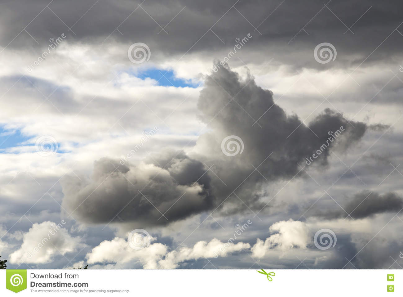 Cumulus Clouds And Grey Storm Clouds Gathering On Blue Sky Stock.