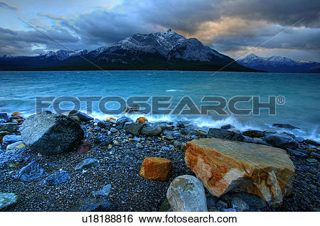 Stock Images of Abraham Lake with clearing storm clouds above near.