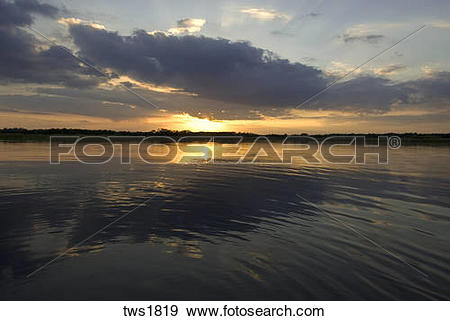 Stock Photograph of Lake reflection highlights sunset and clouds.