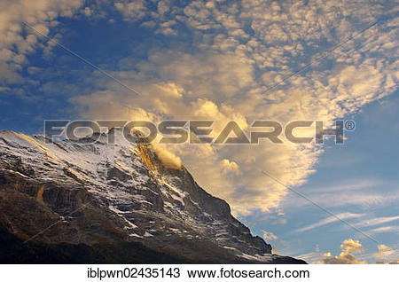 "Stock Photo of ""The Eiger North Face at sunset with clouds."