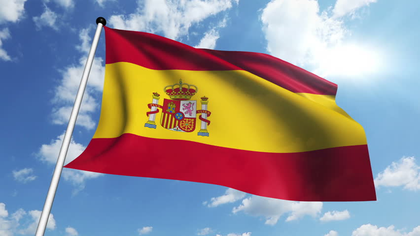Spanish Flag Waving Over A Blue Cloudy Sky Stock Footage Video.