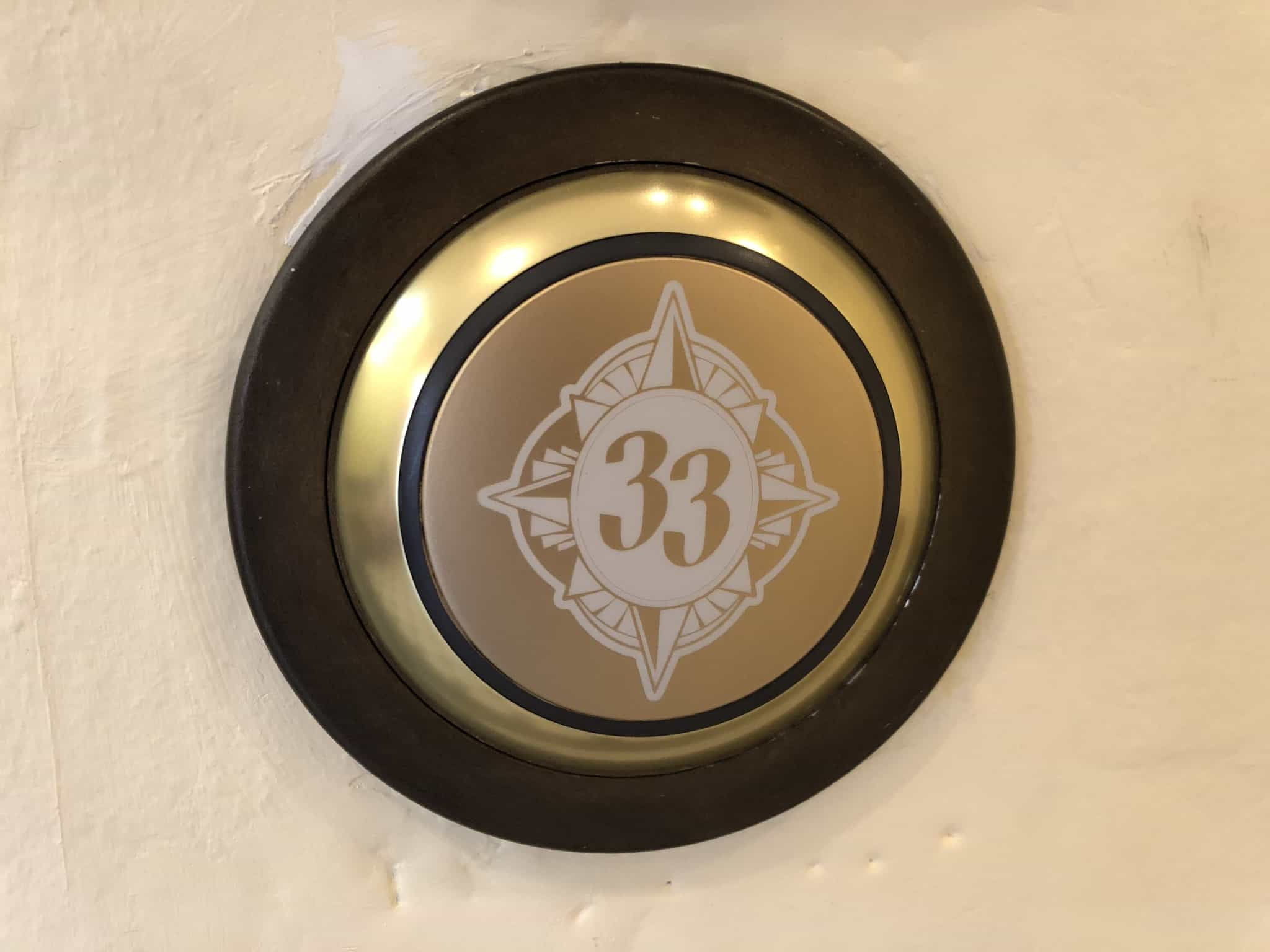 PHOTOS: Club 33 Logo Installed at Catwalk Bar at Disney\'s.