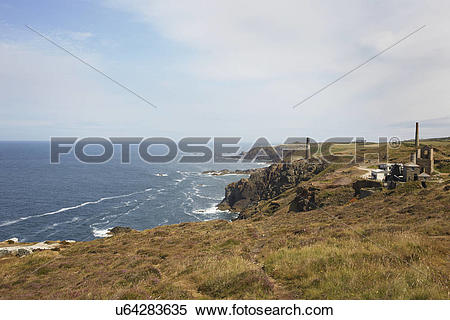 Stock Image of Distant view of tin mine ruins on coastal path.