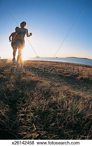 Pictures of Young Couple Jogging Along a Coastal Path x26142458.