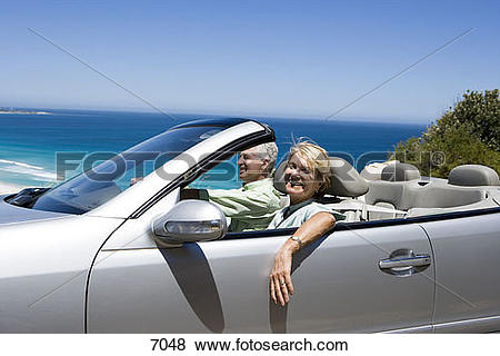 Pictures of South Africa, Western Cape, senior couple driving in.