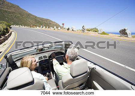 Stock Photo of South Africa, Western Cape, senior couple driving.