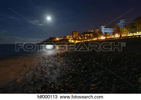 Stock Photo of Portugal, Madeira, Coastal town, beach at night.