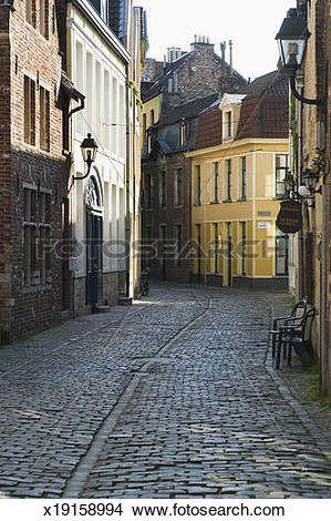 Stock Photo of Narrow cobbled street with houses, Belgium, Bruges.