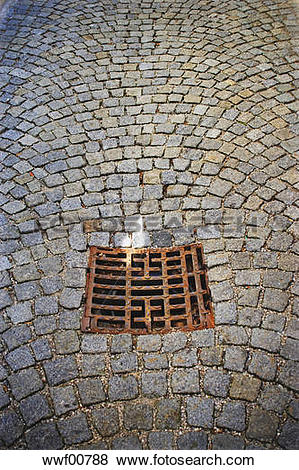 Pictures of Cobbled pavement, sewer grid, elevated view wwf00788.