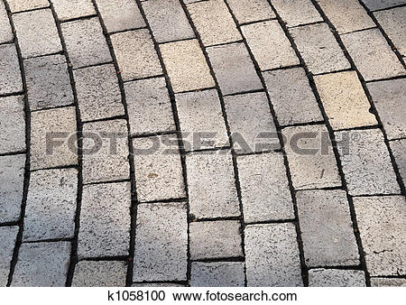 Stock Photography of Bent rows of grey cobble pavement k1058100.