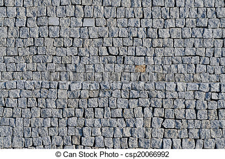 Stock Photographs of Cobbled pavement pattern made of granite.