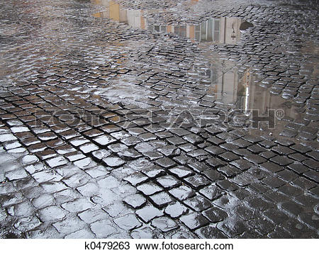 Stock Photo of Wet cobbled street in Rome k0479263.
