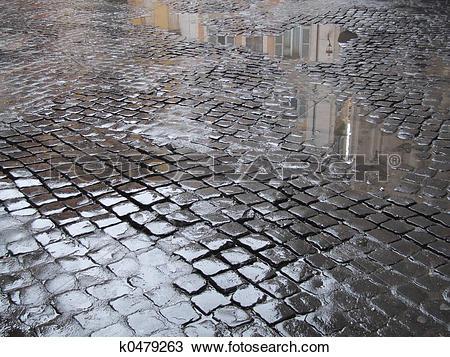 Stock Photo of Wet cobbled street in Rome k0479263.
