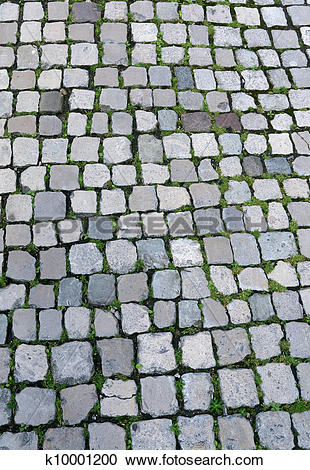 Stock Photography of An old English cobbles road close up.