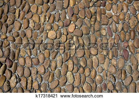 Stock Photography of Old rounded cobbles k17318421.