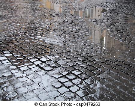 Stock Photos of Wet cobbled street in Rome.