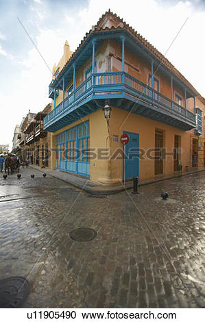 Stock Photography of Turquoise shutters on a historic landmark.