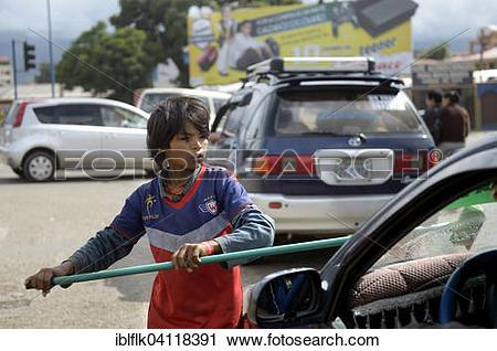Stock Photography of Street child cleaning windshield, Cochabamba.