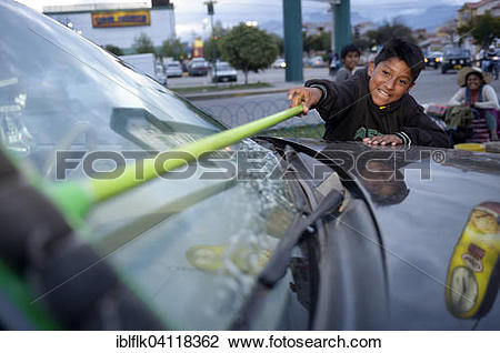 Stock Photo of Street kid, boy, 11 years, cleaning windshield.
