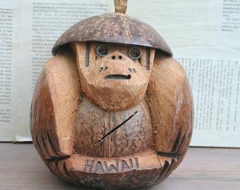 Coconut falling on monkey head clipart.