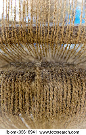 """Stock Photography of """"Making ropes from coconut fibres in a small."""