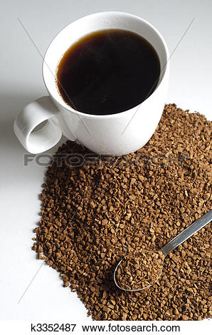 Picture of Pile of Decaffeinated coffee granules with spoon and.