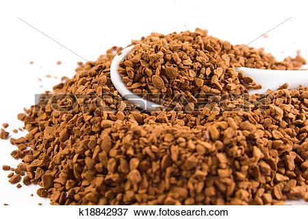 Picture of coffee granules and a white spoon k18842937.