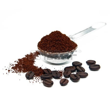 Coffeebeans And Grounded Coffee With A Measure Spoon Stock Photo.