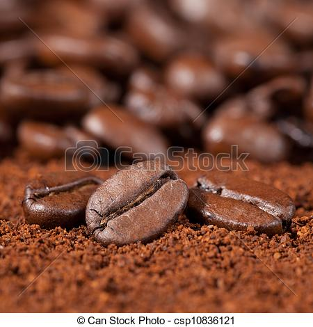 Stock Photo of Macro shot of coffee beans on coffee powder with.