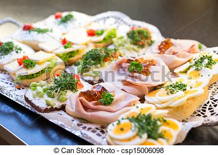 Stock Photographs of Sandwiches with cold cuts at a buffet.