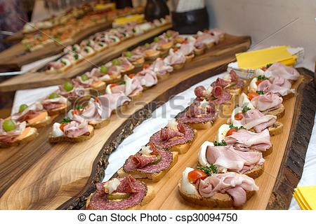 Stock Images of rustic cold buffet on a wooden board.