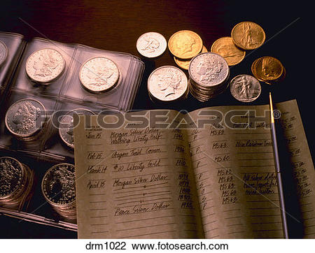 Stock Photo of Gold and silver coins with stamp collecting ledger.