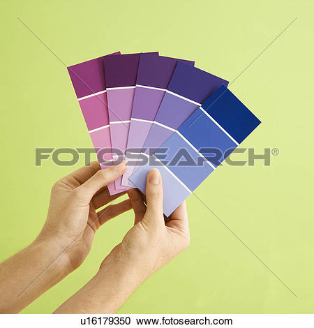 Stock Photography of Caucasian female hands holding paint color.