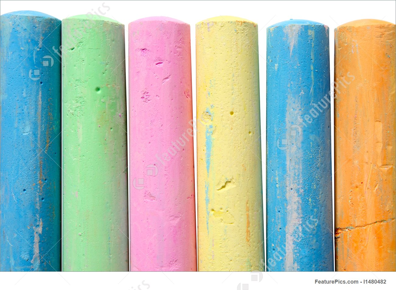 Artistic Tools: Colourful large chalk sticks on a white background..