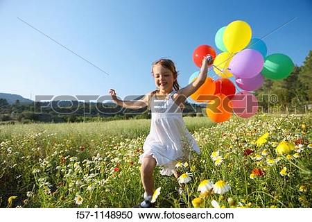 Stock Photography of Little girl running with coloured balloons.