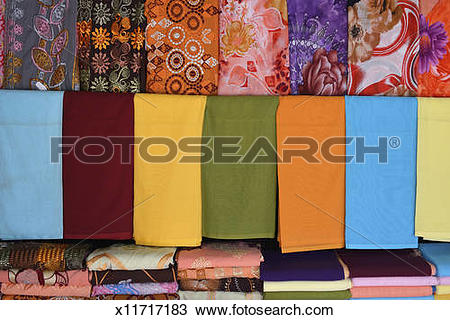 Stock Photo of Brightly coloured scarves on display at market.