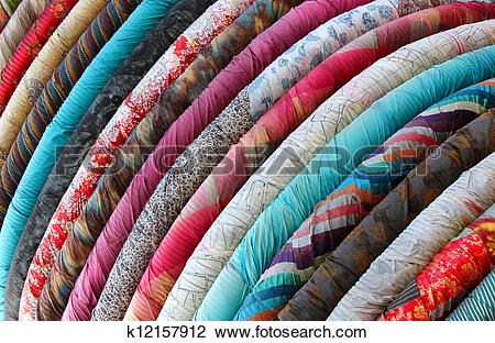 Stock Photo of Rolls of colourful material or fabric k12157912.