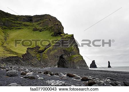 Stock Photo of Columnar basalt cave and black sand, Vik Beach, Vik.