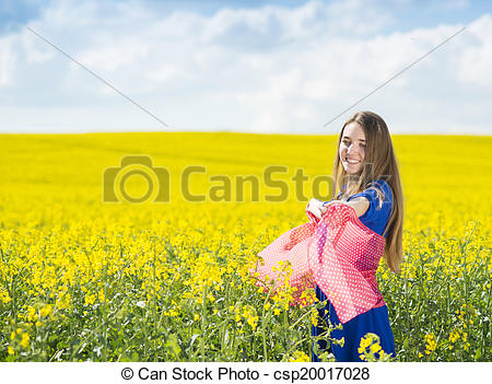 Stock Photo of Girl in colza field.