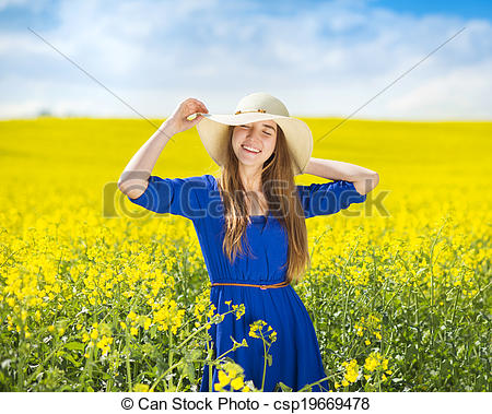 Picture of Girl in colza field.