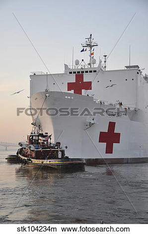 Stock Photo of The hospital ship USNS Comfort departs for.
