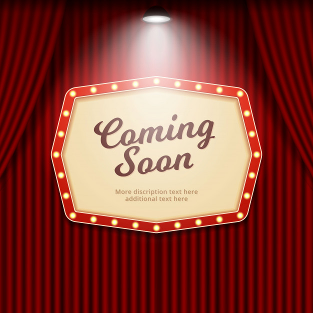 Coming soon retro theater sign illuminated by spotlight on.