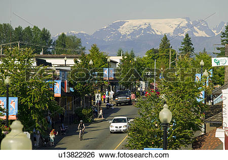 Stock Images of The Comox Glacier overlooks the main street of.