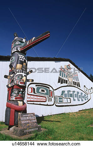 Stock Photo of First Nation's totem pole and longhouse, Comox.