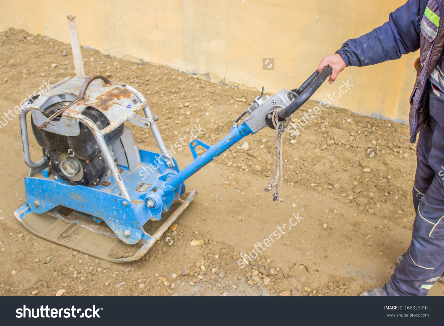 Worker Vibrating Plate Compactor Machine Sand Stock Photo.