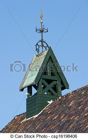 Stock Photography of Wooden belfry with wind vane and compass card.