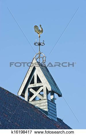 Picture of Wooden belfry with weather vane and compass card.