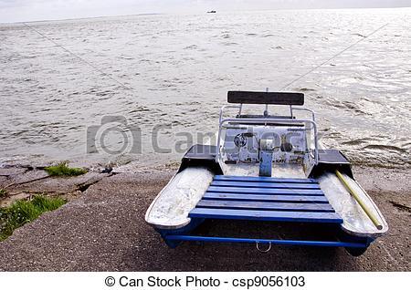 Stock Photos of water bike catamaran on lake concrete pier ship.