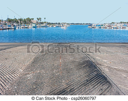 Stock Photographs of Concrete boat ramp going down into the water.