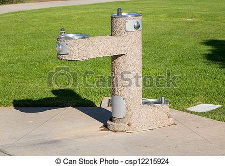 Stock Photo of Concrete drinking fountain in park.